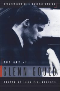 "Photograph of Glenn Gould at the piano.On the book cover of ""The Art of Glenn Gould""."